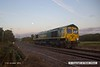 161017-003  With the sun just rising and the moon close to setting, Freightliner class 66/5 no 66585 The Drax Flyer passes the former Clipstone junctions, running light as 0Y37, 06.26 Doncaster up decoy to Thoresby colliery junction. This was heading onto the High Marnham Test Track as standby loco for the new HOBC system that is currently undergoing commissioning trials & staff familiarisation.