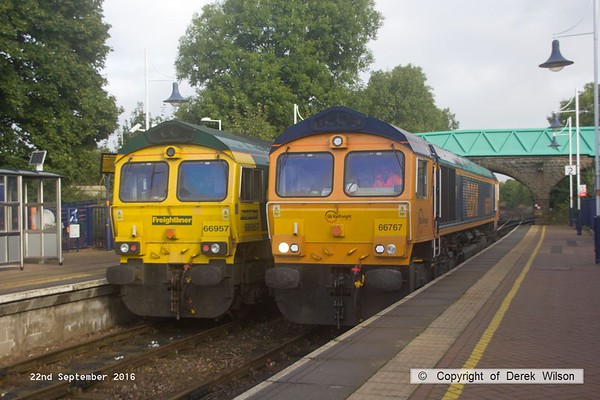 190922-011  Two 66's passing at Shirebrook. Freightliner 66957 is waiting for GB Railfreight 66767 to clear Shirebrook Junction so that it can proceed as 0K18, 08.30 Toton north yard to High Marnham., whilst 66767 is heading to the wagon works as 0F87, 07.58 Doncaster down decoy to Shirebrook, W.H. Davis.