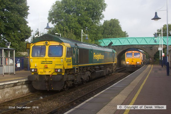 190922-007  Two 66's passing at Shirebrook. Freightliner 66957 is waiting for GB Railfreight 66767 to clear Shirebrook Junction so that it can proceed as 0K18, 08.30 Toton north yard to High Marnham., whilst 66767 is heading to the wagon works as 0F87, 07.58 Doncaster down decoy to Shirebrook, W.H. Davis.