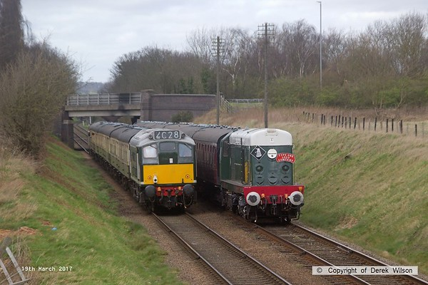 170319-091  Captured passing at Woodthorpe are the 13:37 Rothley Brook - Loughborough, powered (top & tail) by 33063 & D5185, and the 14:15 Loughborogh - Leicester North, with D8098 at the helm.