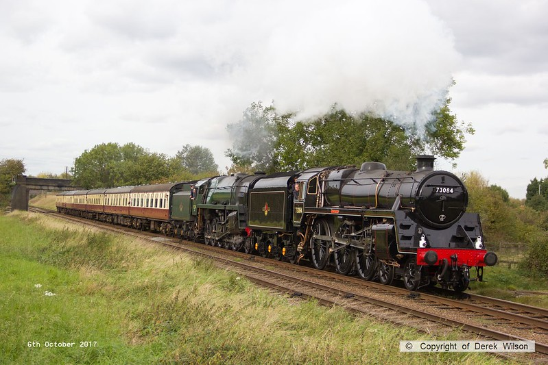 171006-068  BR 5MT 4-6-0 No 73156, running as 73084 Tintagal is captured passing Woothorpe, piloting 9F 2-10-0 No 92214 Leicester City with the 15:15 Loughborough - Leicester North. The 9F was running as a replacement for 73156. All could not have been well though as 73156 was retired again afterwards and took no further part in the gala.
