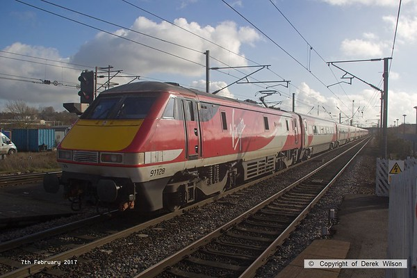 170207-035  Virgin East Coast class 91 No 91129 Intercity 50 is captured propelling 1E10, the 10:00 Edinburgh - London King's Cross away from Newark North Gate.