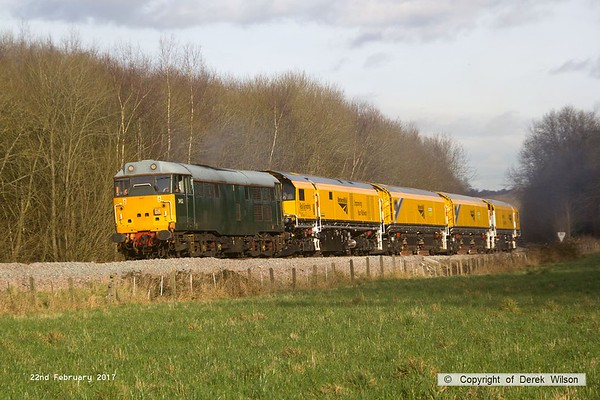 170222-022  DCR class 31 No 31452 is captured pulling away from Boughton Junction on the High Marnham Test Track, in tow is Loram CRG(01) Corrective Rail Grinder consisting of DR79301, 302, 303, and 304. On leaving the test track it went forward as 4Z01, 15:00 Thoresby Colliery Junction - Derby RTC.