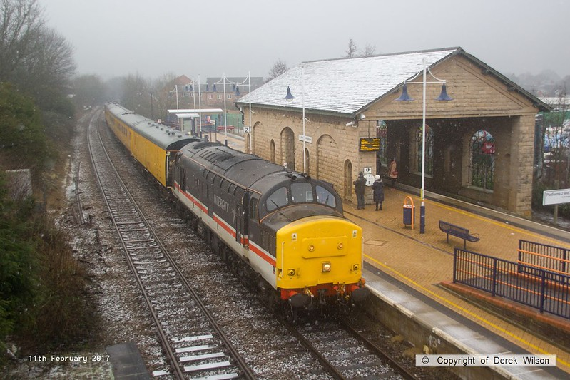 170211-006  Network Rail test train, PLPR2 (Plain Line Pattern Recognition 2) saunters through Mansfield Woodhouse on the Robin Hood Line during a snow shower, running as 1Q68, 02:19 Leeds Neville Hill T.&R.S.M.D. - Derby RTC. Seen leading is Intercity swallow livery No 37254, whilst at the rear is 37025 in BR Large Logo blue livery. Both are now operated by Colas Rail Freight, 37025 has recently been restored to main line duty after a long spell in privatisation.