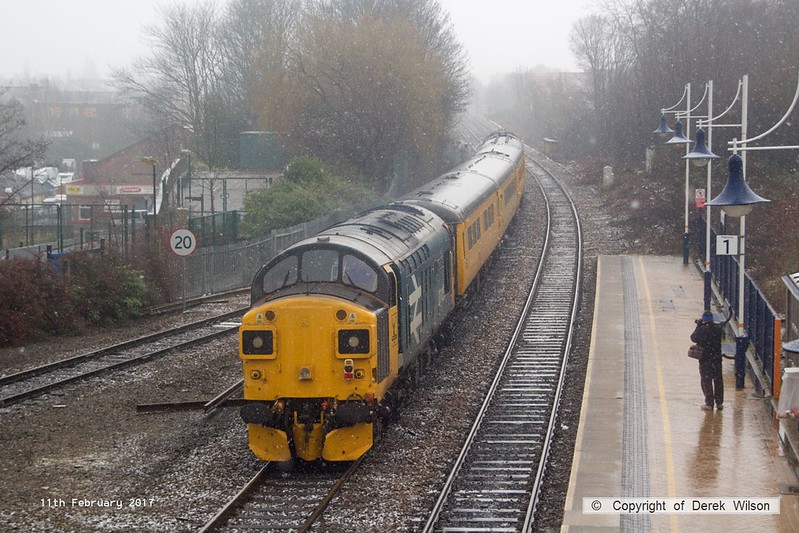 170211-010  Network Rail test train, PLPR2 (Plain Line Pattern Recognition 2) saunters through Mansfield Woodhouse on the Robin Hood Line during a snow shower, running as 1Q68, 02:19 Leeds Neville Hill T.&R.S.M.D. - Derby RTC. Seen leading is Intercity swallow livery No 37254, whilst at the rear is 37025 in BR Large Logo blue livery. Both are now operated by Colas Rail Freight, 37025 has recently been restored to main line duty after a long spell in privatisation.