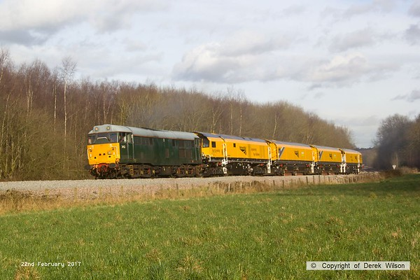 170222-025  DCR class 31 No 31452 is captured pulling away from Boughton Junction on the High Marnham Test Track, in tow is Loram CRG(01) Corrective Rail Grinder consisting of DR79301, 302, 303, and 304. On leaving the test track it went forward as 4Z01, 15:00 Thoresby Colliery Junction - Derby RTC.