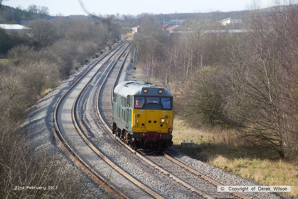 170222-001  DCR green class 31 No 31452 is captured on the High Marnham Test Track, heading to Boughton Junction to collect  Loram CRG(01) Corrective Rail Grinder.