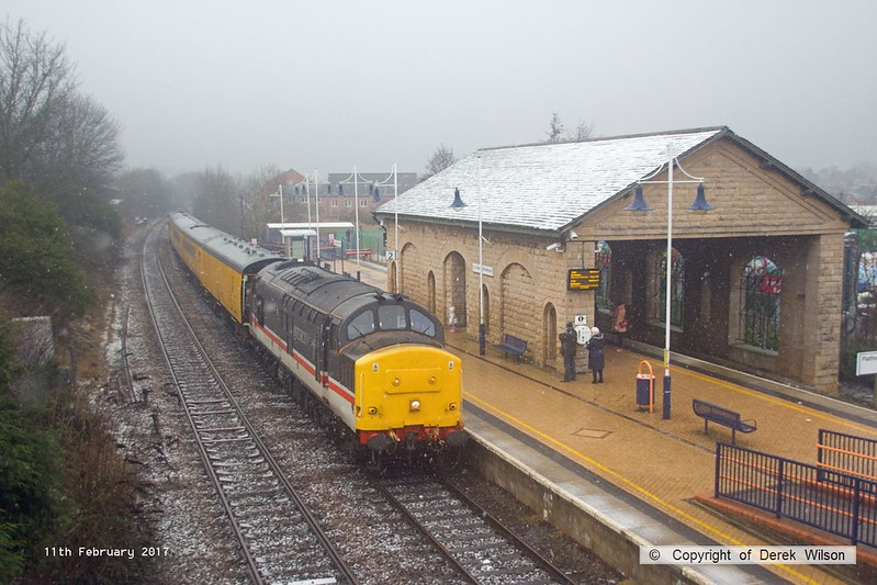 170211-004  Network Rail test train, PLPR2 (Plain Line Pattern Recognition 2) saunters through Mansfield Woodhouse on the Robin Hood Line during a snow shower, running as 1Q68, 02:19 Leeds Neville Hill T.&R.S.M.D. - Derby RTC. Seen leading is Intercity swallow livery No 37254, whilst at the rear is 37025 in BR Large Logo blue livery. Both are now operated by Colas Rail Freight, 37025 has recently been restored to main line duty after a long spell in privatisation.