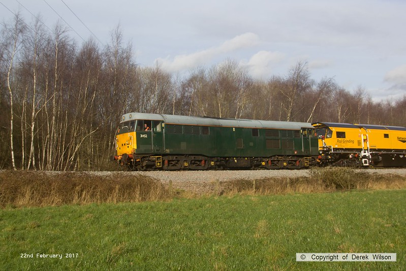 170222-028  DCR class 31 No 31452 is captured pulling away from Boughton Junction on the High Marnham Test Track, in tow is Loram CRG(01) Corrective Rail Grinder consisting of DR79301, 302, 303, and 304. On leaving the test track it went forward as 4Z01, 15:00 Thoresby Colliery Junction - Derby RTC.