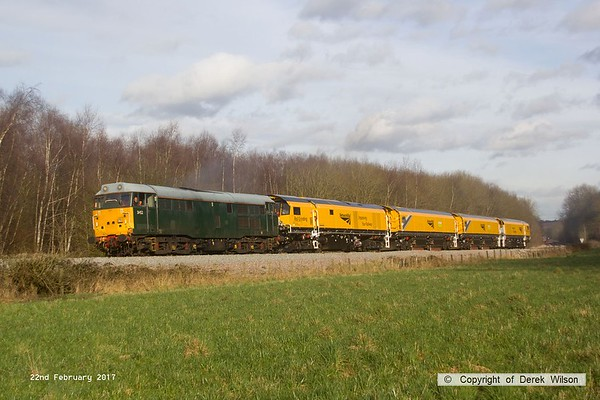 170222-027  DCR class 31 No 31452 is captured pulling away from Boughton Junction on the High Marnham Test Track, in tow is Loram CRG(01) Corrective Rail Grinder consisting of DR79301, 302, 303, and 304. On leaving the test track it went forward as 4Z01, 15:00 Thoresby Colliery Junction - Derby RTC.