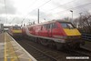 170207-010  A pair of Virgin East Coast class 91's at Newark North Gate. On the left, stood in platform 2 is 91124 at the rear of 1E06, the 06:50 Glasgow Central - London King's Cross, whilst to the right 91129 speeds past with 1D09, the 10:03 London King's Cross - Leeds.