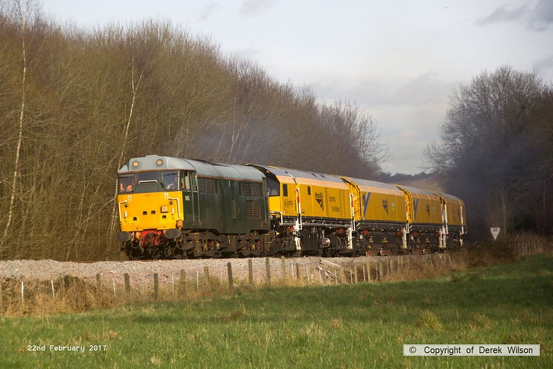 170222-020  DCR class 31 No 31452 is captured pulling away from Boughton Junction on the High Marnham Test Track, in tow is Loram CRG(01) Corrective Rail Grinder consisting of DR79301, 302, 303, and 304. On leaving the test track it went forward as 4Z01, 15:00 Thoresby Colliery Junction - Derby RTC.
