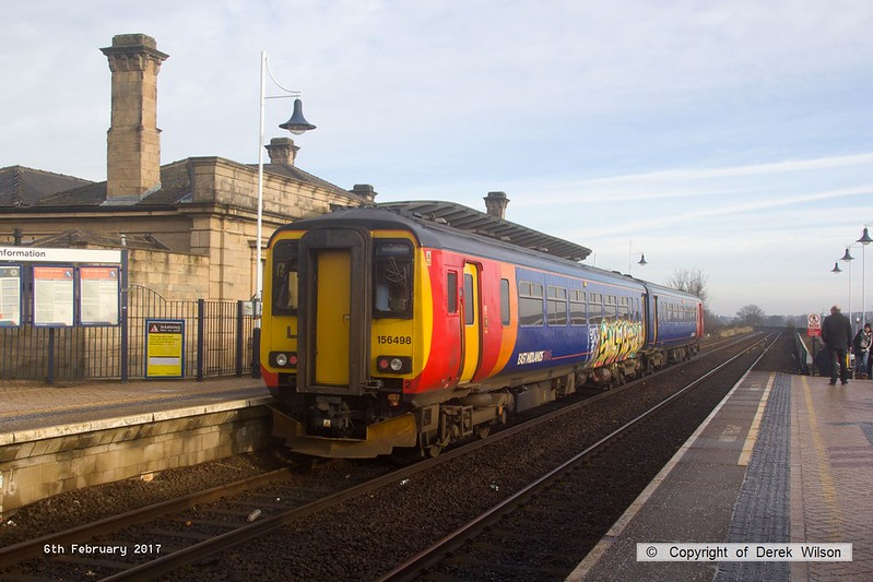 170206-001  East Midlands Trains graffiti covered class 156 sprinter unit No 156498 callas at Mansfield with 2H07, the 09:55 Nottingham - Mansfield Woodhouse.
