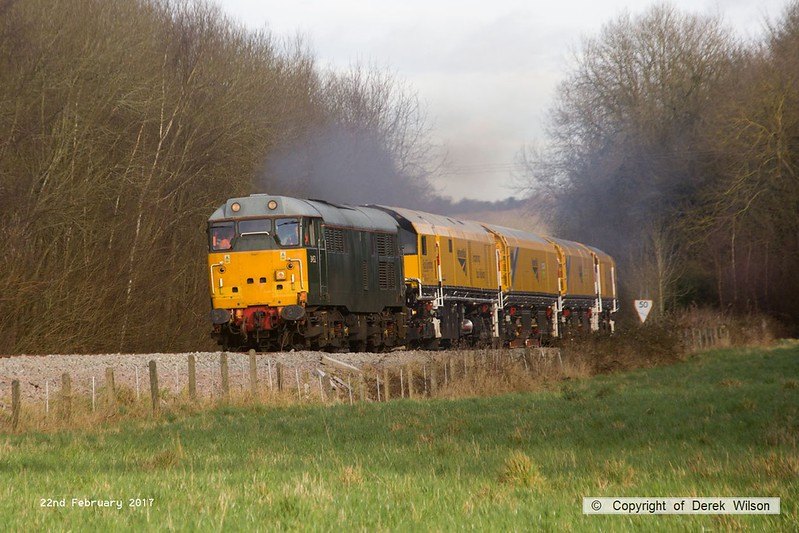 170222-016  DCR class 31 No 31452 is captured pulling away from Boughton Junction on the High Marnham Test Track, in tow is Loram CRG(01) Corrective Rail Grinder consisting of DR79301, 302, 303, and 304. On leaving the test track it went forward as 4Z01, 15:00 Thoresby Colliery Junction - Derby RTC.