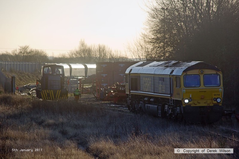 170105-004  GB Railfreight class 66/7 No 66744 Crossrail is seen in W.H. Davis's exchange siding. Davis's Andrew Barclay 0-4-0DH No 499 has just deposited two modified hoppers onto the end of the branch and is seen heading back to the yard to collect two more.