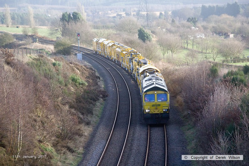 170111-014  Freightliner class 66/5 No 66596 is captured approaching Welbeck Junction, on the former Lancashire Derbyshire & East Coast Railway, powering train 6Y37 13:05 Thoresby Colliery Junction - Toton North Yard. It is seen with a High Output Ballast Cleaner that has been on the High Marnham Test Track for commissioning trials and staff familiarisation. An attempt to take it to Toton the previous week had to be aborted due to 'issues'.