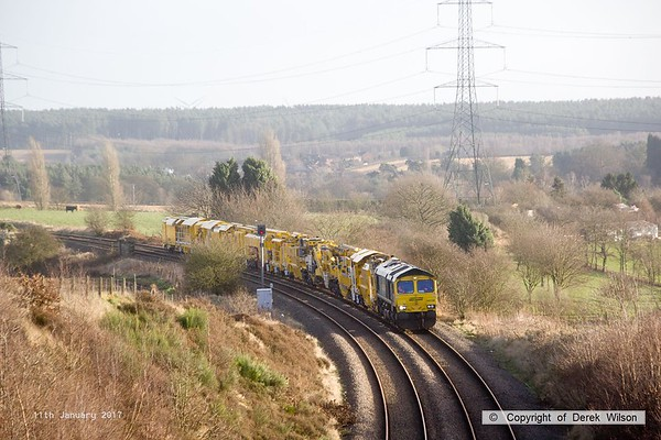 170111-011  Freightliner class 66/5 No 66596 is captured approaching Welbeck Junction, on the former Lancashire Derbyshire & East Coast Railway, powering train 6Y37 13:05 Thoresby Colliery Junction - Toton North Yard. It is seen with a High Output Ballast Cleaner that has been on the High Marnham Test Track for commissioning trials and staff familiarisation. An attempt to take it to Toton the previous week had to be aborted due to 'issues'.