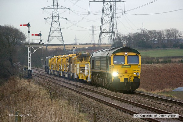 170106-004  Freightliner class 66/5's No's 66564 and 66528 are captured passing the former Clipstone West Junction, top & tail with train 7Y37, 09:00 Thoresby Colliery Junction - Toton North Yard. It left Thoresby 245 minutes late after issues with the HOBC, some of it being out of gauge for the booked route, so after leaving it behind at Tuxford it finally got away with converted YSA wagon DR 979411, MFS-A DR 92283 and 4 MFS Octopus wagons, of which two had wheel flats, so probably why it ran as class 7.  .