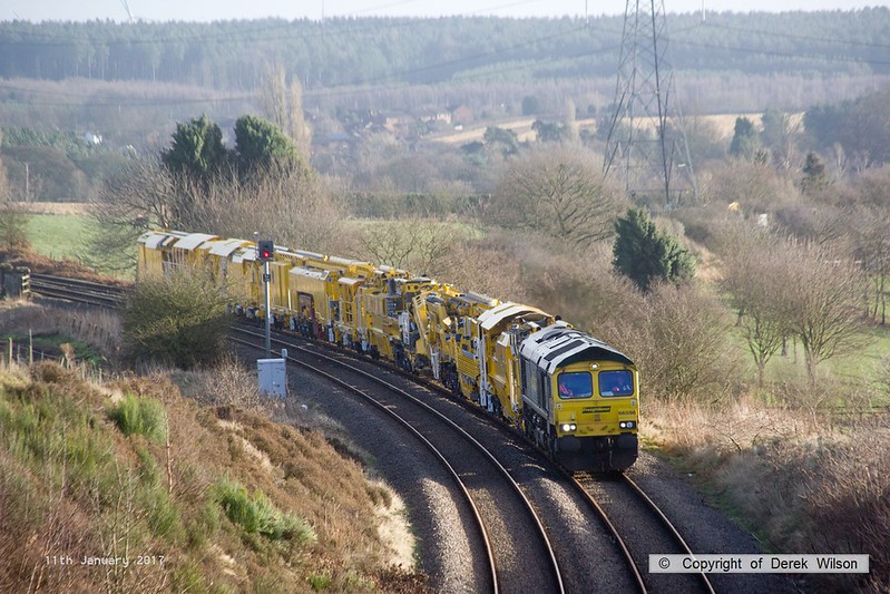 170111-012  Freightliner class 66/5 No 66596 is captured approaching Welbeck Junction, on the former Lancashire Derbyshire & East Coast Railway, powering train 6Y37 13:05 Thoresby Colliery Junction - Toton North Yard. It is seen with a High Output Ballast Cleaner that has been on the High Marnham Test Track for commissioning trials and staff familiarisation. An attempt to take it to Toton the previous week had to be aborted due to 'issues'.