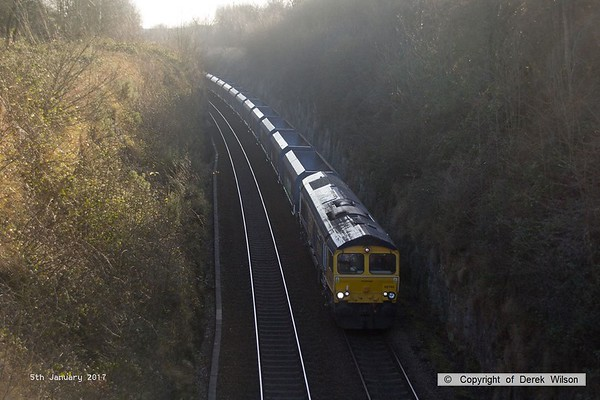 170105-010  GB Railfreight class 66/7 No 66744 Crossrail is captured passing Shirebrook East Junction, powering train 4F88, 12:15 Shirebrook, W.H. Davis - Doncaster Down Decoy, with 25 modified hoppers in tow. It was booked to take the wagons to Rylstone but was terminated at Doncaster instead.