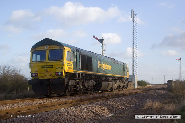 170111-006  Freightliner class 66/5 No 66596 passes Clipstone East Junction, running as 0Y37, 10:05 Toton North Yard - Thoresby Colliery Junction. This was heading to Tuxford to collect a High Output Ballast Cleaner that has been commissioned on the test track, an attempt to take it to Toton the previous week was aborted.