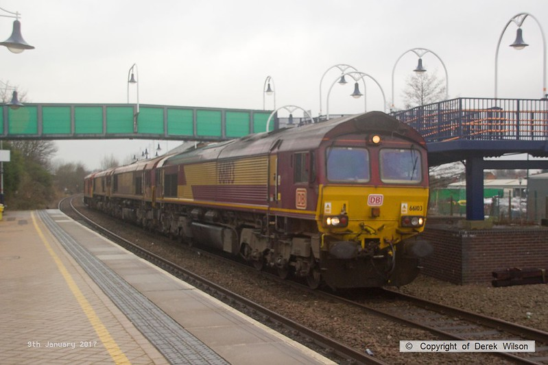 170109-006  A DB Cargo light engine convoy is seen strolling through a rainy Mansfield Woodhouse on the Robin Hood Line. Powering the ensemble is class 66/0 No 66103, followed by Euro Cargo Rail class 66/0's No's 66022  & 66052, whilst bringing up the rear is class 60 No 60063, all dead-in-tow. The two Euro Cargo Rail loco's have returned from France and are completing their journey to Toton depot for maintenance.