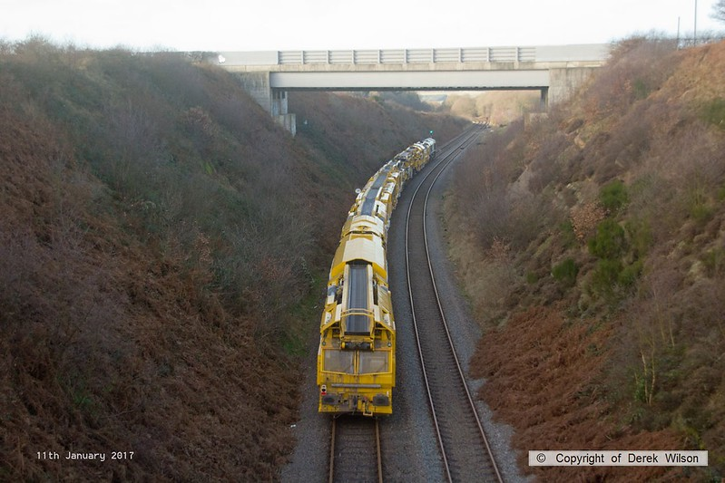 170111-017  Freightliner class 66/5 No 66596 is captured approaching Welbeck Junction, on the former Lancashire Derbyshire & East Coast Railway, powering train 6Y37 13:05 Thoresby Colliery Junction - Toton North Yard. It is seen with a High Output Ballast Cleaner that has been on the High Marnham Test Track for commissioning trials and staff familiarisation. An attempt to take it to Toton the previous week had to be aborted due to 'issues'.