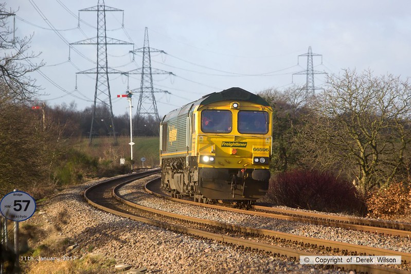 170111-001  Freightliner class 66/5 No 66596 passes Clipstone Junctions, running as 0Y37, 10:05 Toton North Yard - Thoresby Colliery Junction. This was heading to Tuxford to collect a High Output Ballast Cleaner that has been commissioned on the test track, an attempt to take it to Toton the previous week was aborted.
