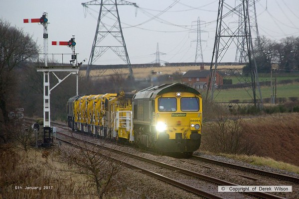 170106-002  Freightliner class 66/5's No's 66564 and 66528 are captured passing the former Clipstone West Junction, top & tail with train 7Y37, 09:00 Thoresby Colliery Junction - Toton North Yard. It left Thoresby 245 minutes late after issues with the HOBC, some of it being out of gauge for the booked route, so after leaving it behind at Tuxford it finally got away with converted YSA wagon DR 979411, MFS-A DR 92283 and 4 MFS Octopus wagons, of which two had wheel flats, so probably why it ran as class 7.  .