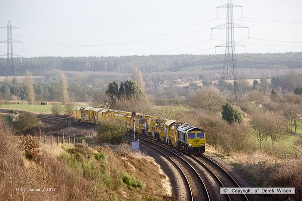 170111-009  Freightliner class 66/5 No 66596 is captured approaching Welbeck Junction, on the former Lancashire Derbyshire & East Coast Railway, powering train 6Y37 13:05 Thoresby Colliery Junction - Toton North Yard. It is seen with a High Output Ballast Cleaner that has been on the High Marnham Test Track for commissioning trials and staff familiarisation. An attempt to take it to Toton the previous week had to be aborted due to 'issues'.