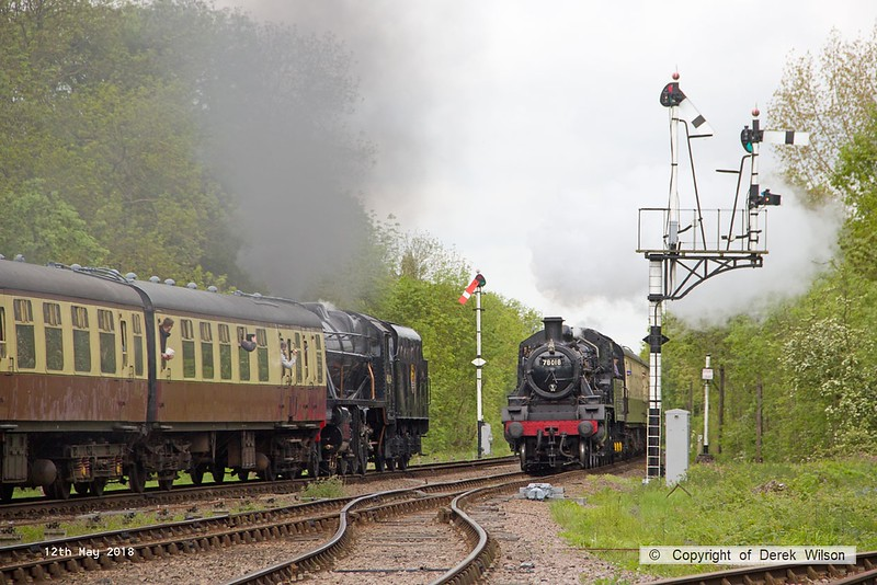 180512-020  Memory's of the past, the Great Central must be unique now, to be able to capture the sight of trains passing on the main line. Here we see BR standard 2MT No. 78018 with, 2A12, the 10:40 Loughborough - Leicester North., whilst heading away tender-first is LMS Stanier 8F No 48624 with 2B08, the 10:40 Leicester North - Loughborough.