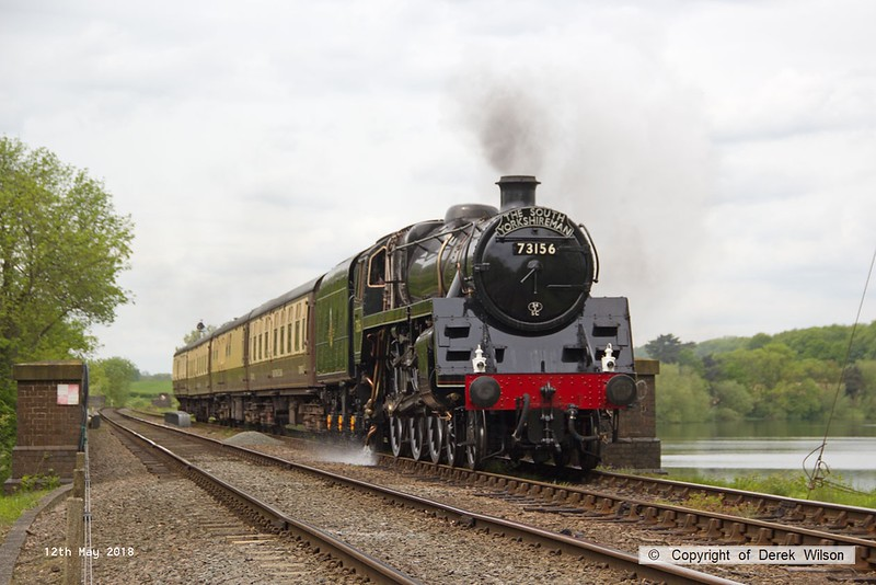 180512-047  BR 5MT 4-6-0  No. 73156 is captured passing Swithland reservoir, powering the dining train, 1A26. the 13:00 Loughborough - Leicester North. This was held at Rothley due to a visitor on board taking ill and a ambulance being summoned.