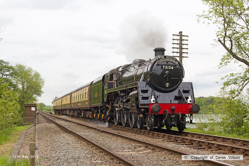 180512-049  BR 5MT 4-6-0  No. 73156 is captured passing Swithland reservoir, powering the dining train, 1A26. the 13:00 Loughborough - Leicester North. This was held at Rothley due to a visitor on board taking ill and a ambulance being summoned.