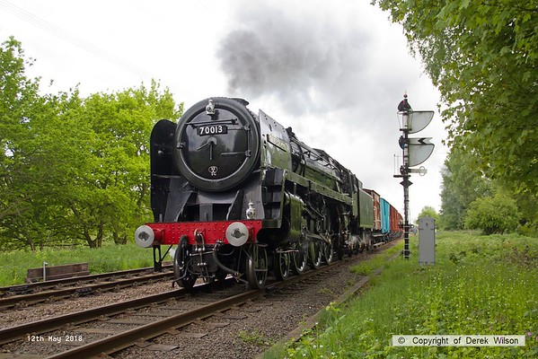 180512-001  BR Britannia 4-6-2 No. 70013 Oliver Cromwell is seen at Swithland, powering 7G54  08:30 Quorn URS - Leicester North. Of note is the smart fish van that has recently received a coat of blue paint.