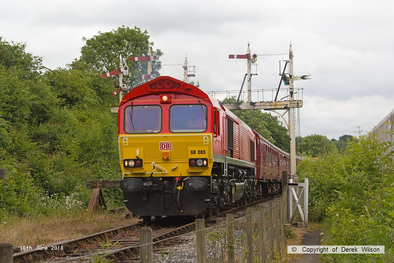 180616-077  DB Cargo class 66/0 No. 66065 passes under the gantry as it heads towards Butterley with the 12:00 Swanwick - Hammersmith. Services were running late due to overnight vandalism, all the signal wires to this gantry having been cut!!