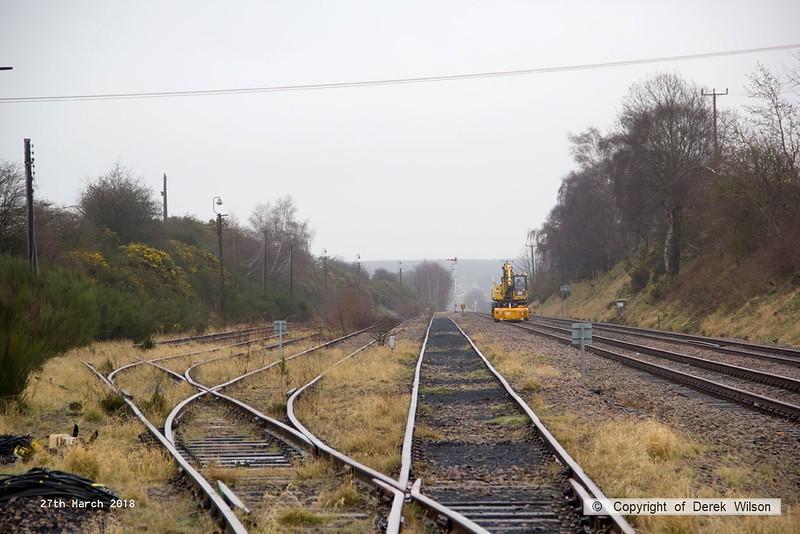 180327-001  The derelict Thoresby sidings, now severed and with all ground signals and point motors removed. One of the Quattro Plant road/railers is still pottering about.