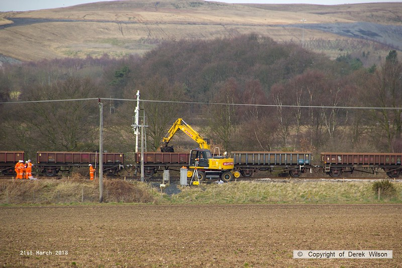 180321-021  A elevated view of Komatsu PW150ES road/railer No. 99709 940 353-6, Quattro Plant fleet No. 413 seen removing the spoil from the down line at Thoresby.