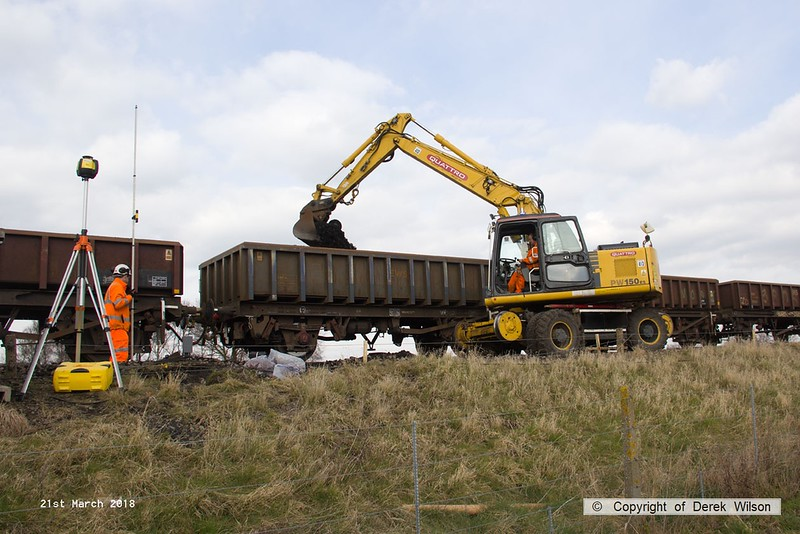 180321-023  Komatsu PW150ES road/railer No. 99709 940 353-6, Quattro Plant fleet No. 413 seen removing the spoil from the down line at Thoresby.