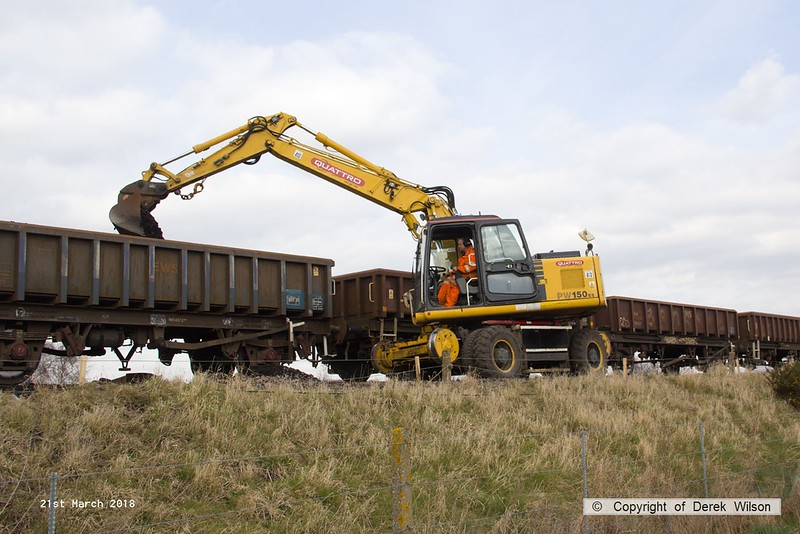 180321-024  Komatsu PW150ES road/railer No. 99709 940 353-6, Quattro Plant fleet No. 413 seen removing the spoil from the down line at Thoresby.