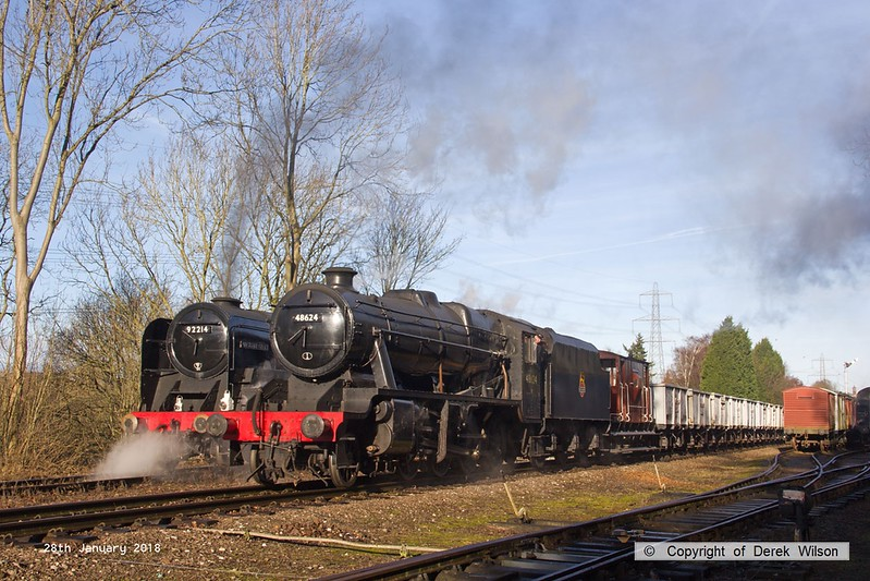 180128-017  LMS 8F 2-8-0 No. 48624 with the mineral wagons in tow is captured passing BR 9F No. 92214 at Rothley.