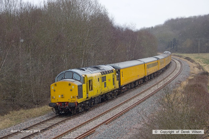 180226-011  Network Rail class 97 No. 97301 is captured nearing Boughton Junction on the High Marnham Test Track, powering (from the rear) 3Z10, 08:12 Derby RTC - High Marnham. Leading the ensemble was DBSO No. 9703.