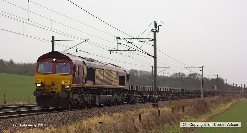 180201-013  Train 4E26, 08:10 Dollands Moor - Scunthorpe with DB Cargo class 66/0 No 66175 at the helm is captured passing Eaton Lane in the pouring rain.