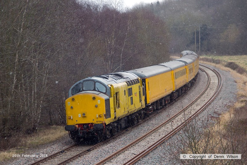 180226-013  Network Rail class 97 No. 97301 is captured nearing Boughton Junction on the High Marnham Test Track, powering (from the rear) 3Z10, 08:12 Derby RTC - High Marnham. Leading the ensemble was DBSO No. 9703.
