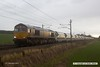 180201-009  GB Railfreight class 66 No. 66765 is captured in the pouring rain, passing Eaton Lane, Retford, powering train 6E84, 08:20 Middleton Towers - Monk Bretton.