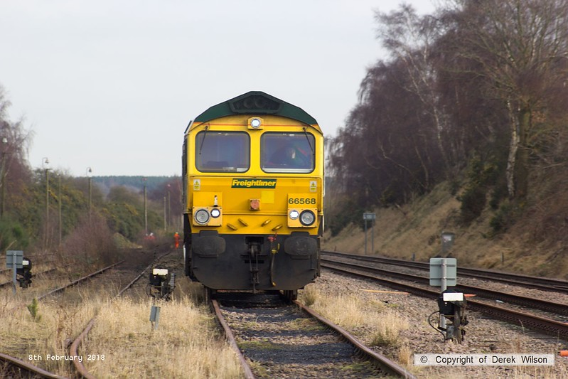 180208-023  Freightliner class 66/5 No. 66568 is captured from the foot crossing at Thoresby, seen at the head of 20 coal hoppers that have been stored since the closure of the colliery.