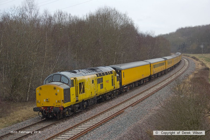 180226-009  Network Rail class 97 No. 97301 is captured nearing Boughton Junction on the High Marnham Test Track, powering (from the rear) 3Z10, 08:12 Derby RTC - High Marnham. Leading the ensemble was DBSO No. 9703.