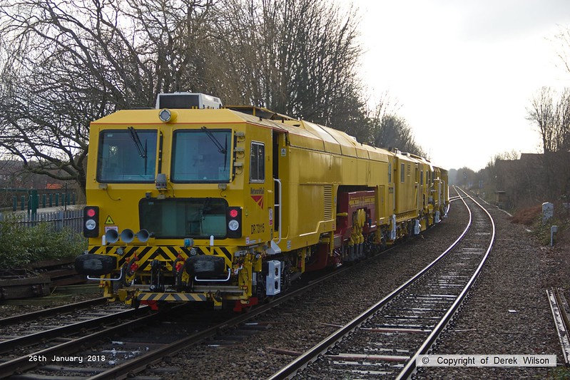 180126-004  After spending a week on the High Marnham Test Track, two Network Rail track machines are captured passing through Mansfield Woodhouse, running as 6U11, 10:33 Thoresby Colliery Junction - Crewe P.A.D. Leading is Plasser & Theurer USP 5000 Ballast Regulator No DR77905, whilst in tow is Plasser & Theurer 09-3X-D-RT Tamper/Liner No DR73115.