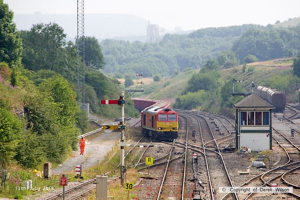 180713-093  DB Cargo class 60 No. 60059 Swinden Dalesman is captured pulling away from the Cemex sidings at Peak Forest with train 6F07, the 14:18 to Dallam Freight Depot