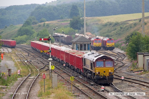 180713-079  DB Cargo class 66/0 No. 66177 is captured passing Peak Forest with train 6H52, 13:07 Dowlow , Briggs sidings - Ashburys S.S. To the left  are 60059 Swinden Dalesman, fired up ready to work 6F07, 14:18 Peak Forest Cemex sidings - Dallam Freight Depot, & 60062 Stainless Pioneer.