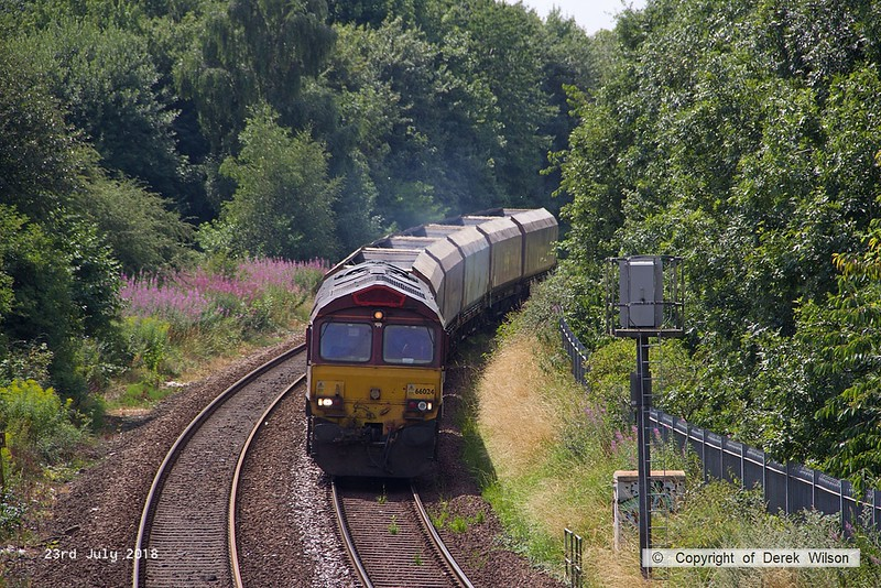 180723-001  DB Cargo class 66/0 No. 66024 is seen from Princes Street footbridge, Mansfield, on the Robin Hood Line, with five HTA hoppers in tow for 'cut & shut' mods, running as 4Z20, 13:34 Toton North Yard - Shirebrook, W.H. Davis.